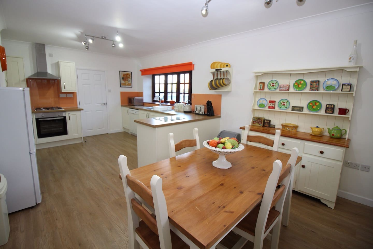 Spacious kitchen diner with gas hob, electric oven, dishwasher, microwave, fridge freezer, kettle, toaster and a feature fireplace. There is also a utility room leading from the kitchen with a washing machine, iron/ironing board and a further sink. If required we can also provide a baby's high chair. On arrival we will ensure there are some basic supplies ready for you, including milk, bread, eggs, butter, orange juice, tea, coffee and sugar.