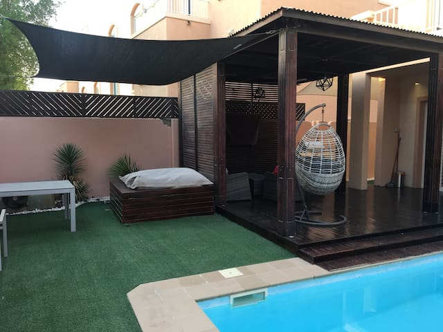 Outdoor gazebo with BBQ and lounge seating and TV