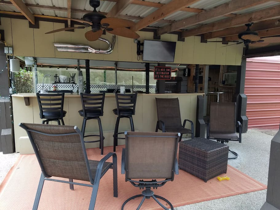 Outdoor Kitchen for BBQ and watching TV.