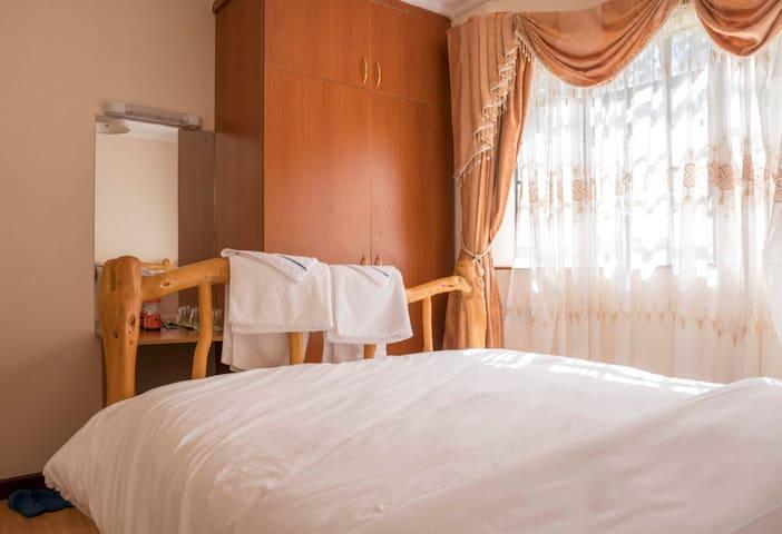 Master Bedroom 1 featuring queen bed