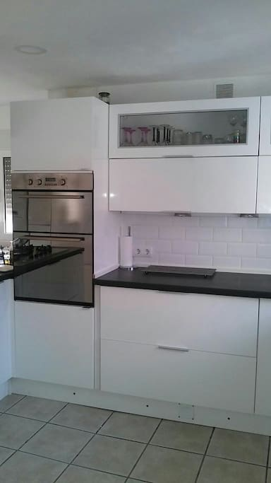 Modern kitchen electric double oven and dishwasher,microwave,gas hob.
