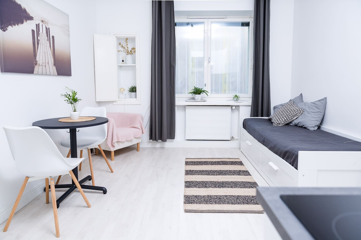 A stylish and clean studio room for max. 3 people. A sofa-bed (160x200cm) fits two persons and we also have one airmatress in the closet that fits one person.