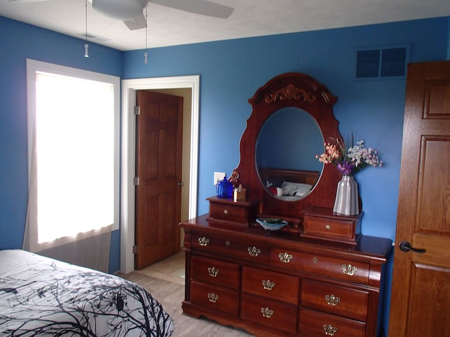This room has a double bed and access to a shared balcony that leads to ground level.