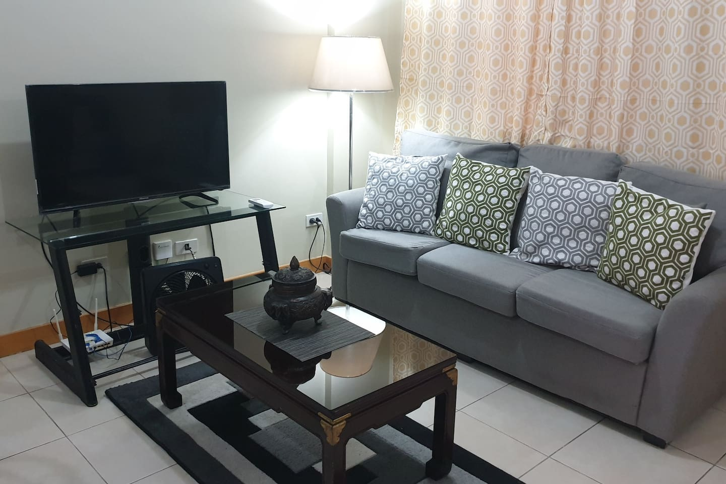 Living room with a 3 seater sofa, 45 inch flat screen tv, 25mbps internet