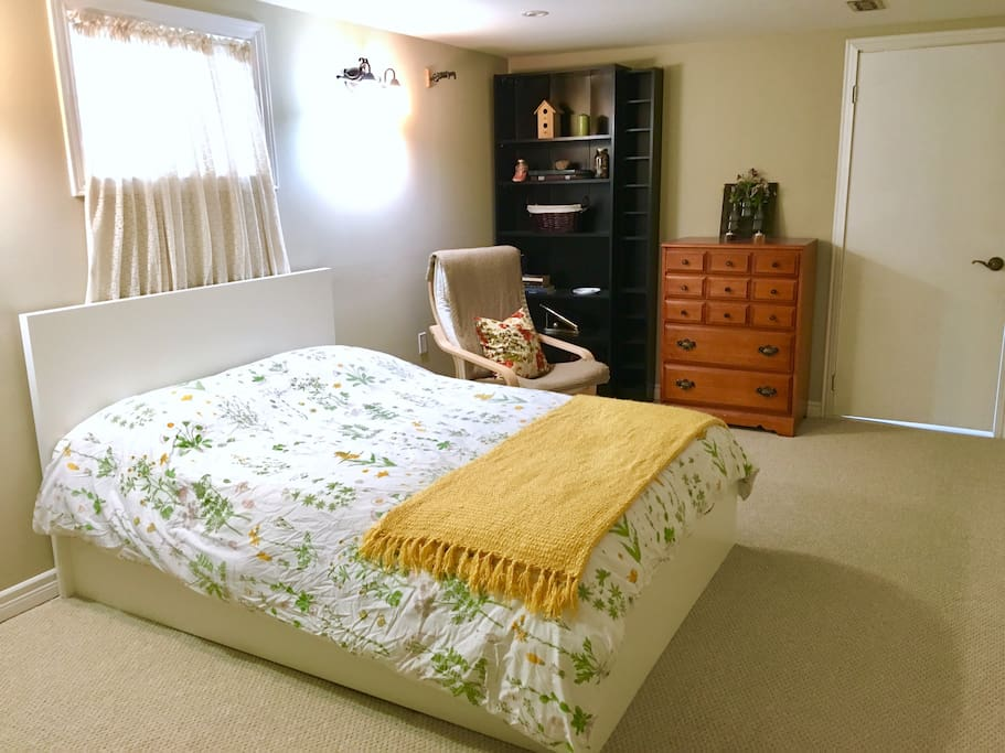 Bright spacious bedroom with double bed