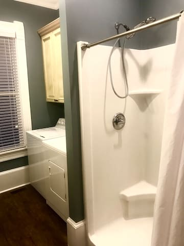 Nice, large walk-in shower with bench and shelf in the bathroom!