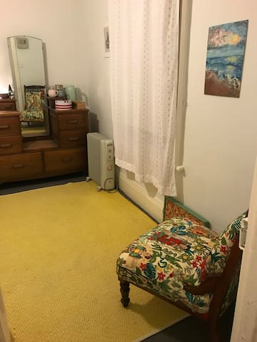 Your room... enjoy a quiet space - actually lots of space :-)  You'll find you have much room for storage in both wardrobe (not pictured) and drawers. Inside I've left a few handy objects for use.