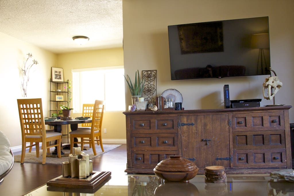 Living room with dining room behind it.
