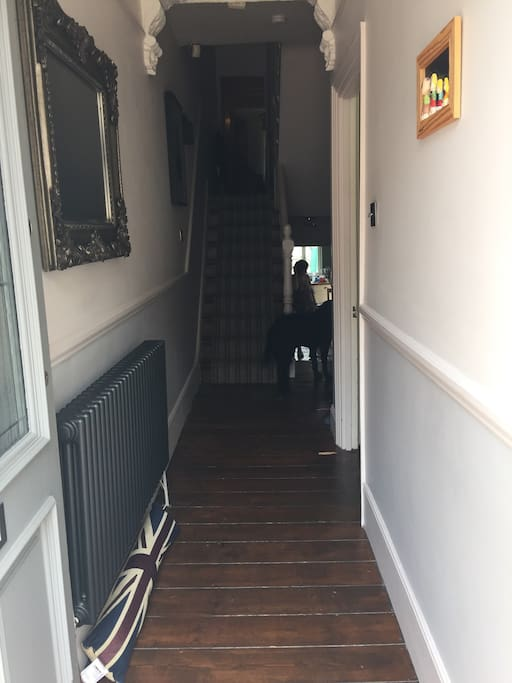 Entrance hall with feature column radiator and mirror