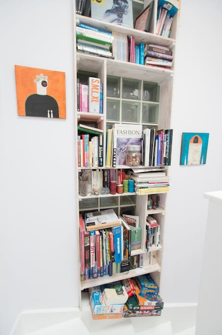 "Library in hallway with books and games (you may read/use but please don't ""borrow"")."