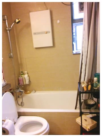 Washroom View from Main Hallway. Hot Tub & Shower, Toilet, Feel free to use the Shampoo & Shower Gel I'll have ready for you, Rack for Stuff!