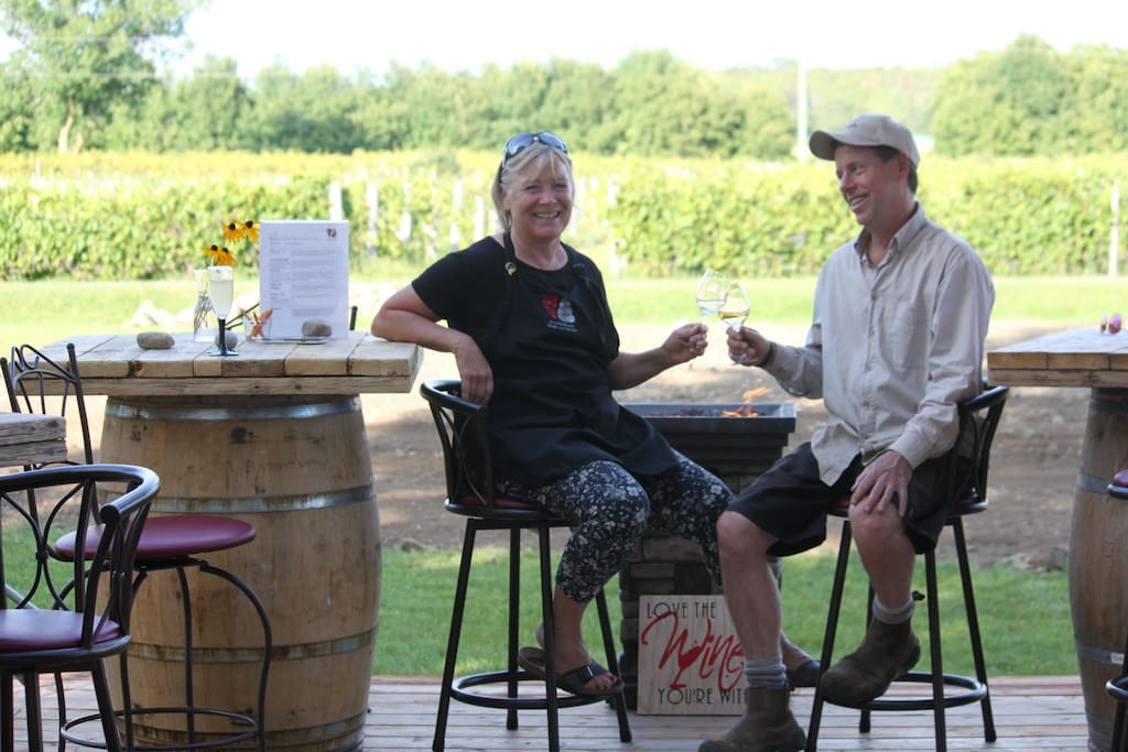your hosts Norene and Marc live next door - sitting on the winery patio overlooking the vineyard