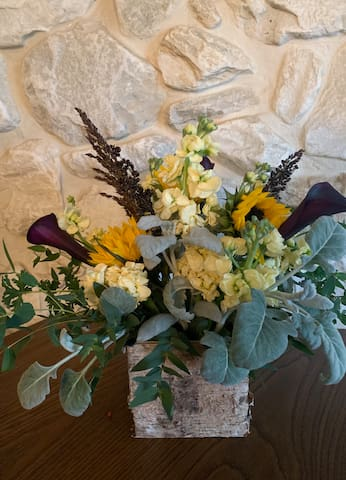 Let us know if you are interested in a custom-designed floral arrangement to take to a local event you're here to attend, or to take home with you.