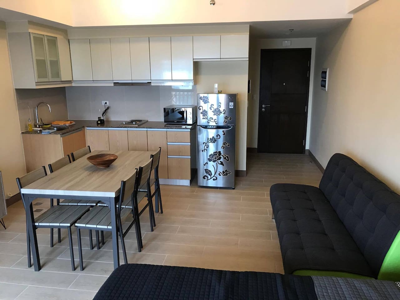 Small kitchen with micro-wave, refrigerator, etc...