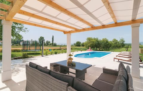 Awesome home in Otok Dalmatinski with WiFi and 5 Bedrooms