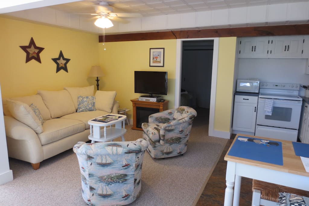 Comfortable Sitting Room, Ceiling Fan with Light. Electric Fire & Flat Screen TV/DVD.