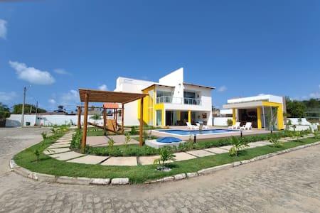 Casa em condomínio perto da praia  em Paripueira
