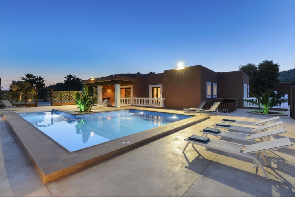Spacious pool area with loungers for all