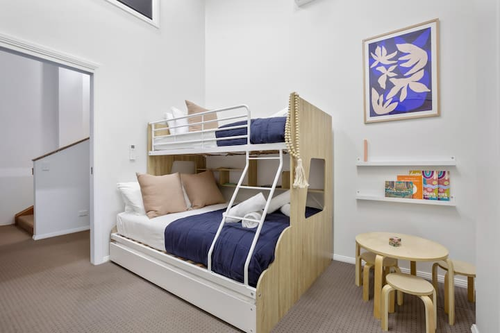 The fifth bedroom is ideal for those travelling with kids. It features a double bunk bed, with a single on the top and an additional trundle, accommodating four guests in total.