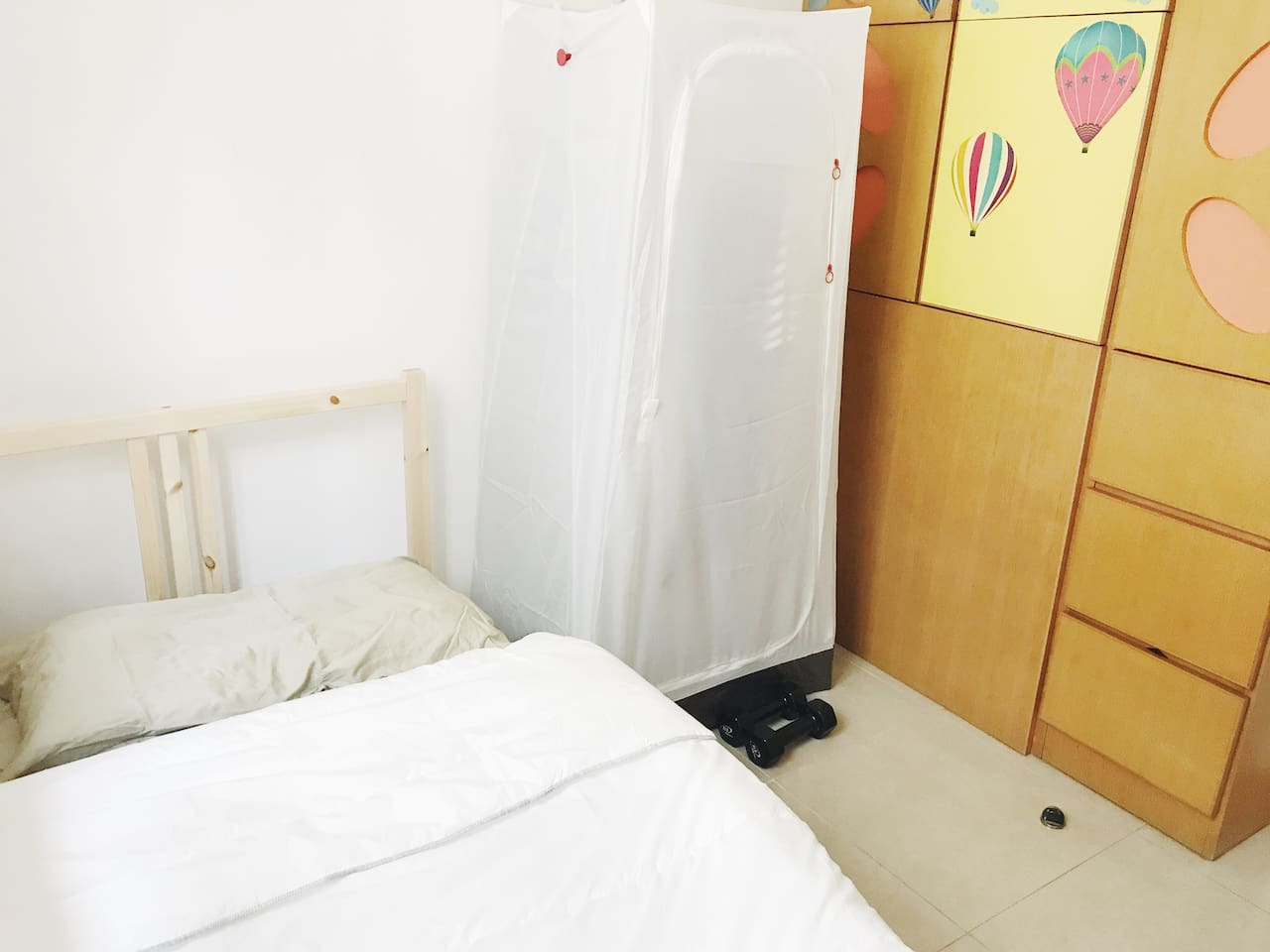 Your single bed and the white one is a handy wardrobe from Ikea you can use!
