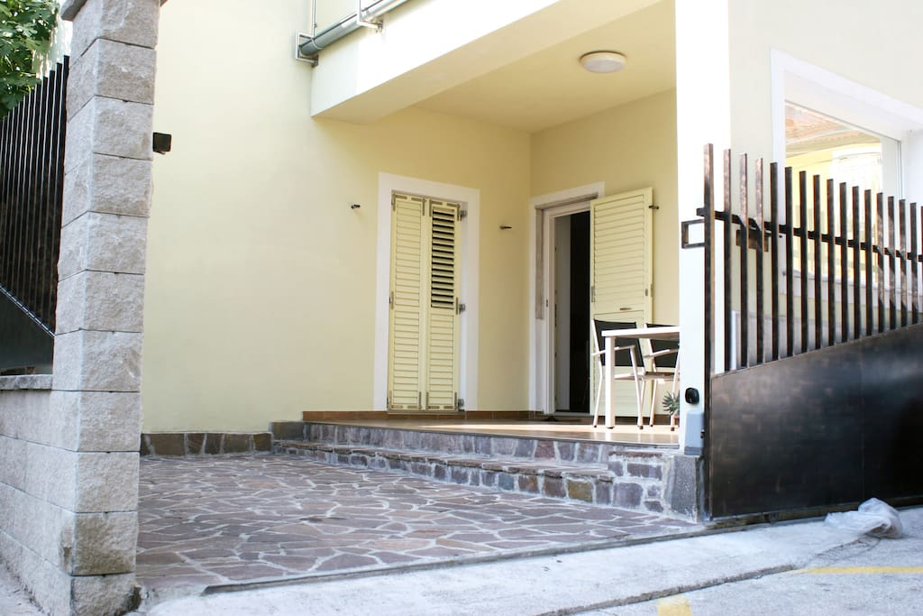 Entrance to the terrace and private parking that belongs to the apartment and entrance to the apartment itself