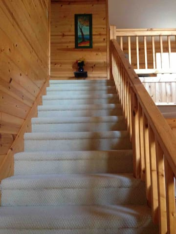 Stairs leading to the second floor master bathroom suite, including master bathroom and loft area.
