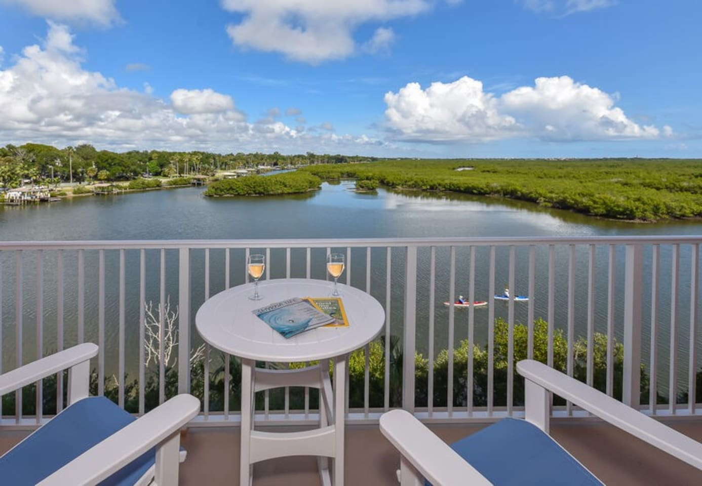 Watch the dolphins play from the private, riverfront balcony