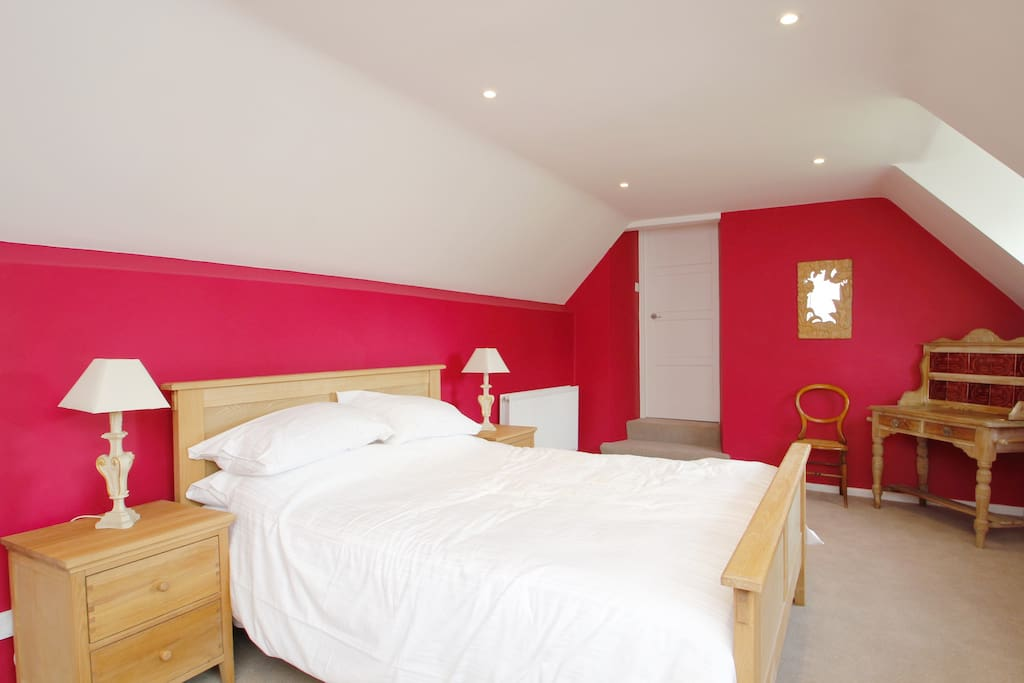 Spacious double bedroom with king size bed. Ensuite bathroom