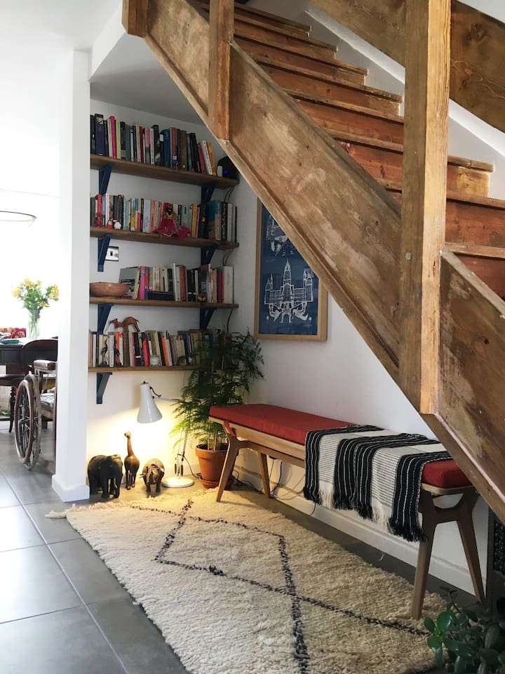 The comfy under stairs reading area. Our guests are welcome to pick a book whilst they are staying with us