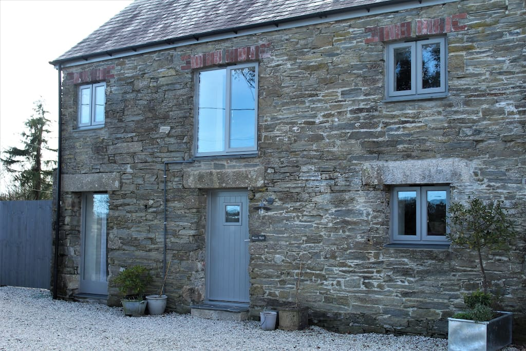 The external view of Pascoe's Pippin from the shared courtyard. The cottage also has a private courtyard garden and parking space.