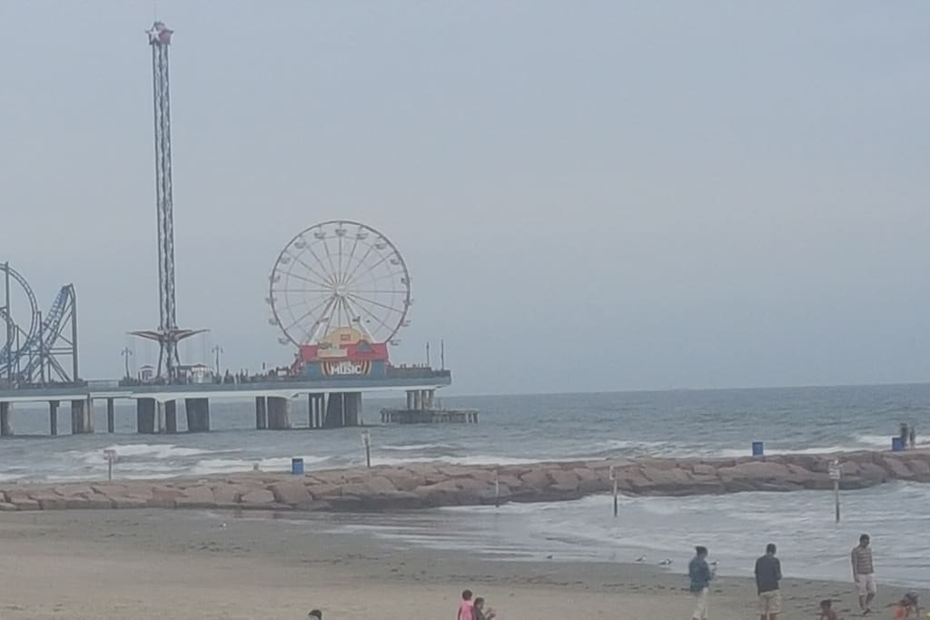 That's Right!  We're walking distance to the Historic Pleasure Pier!  Just a quick walk to the renown Seawall! All from our place Hattie's Place Too!!  Check us out however you desire!!