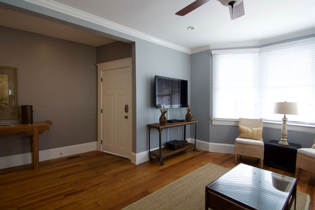"""Living Room (with Queen Sofa Bed & 55"""" HDTV)"""