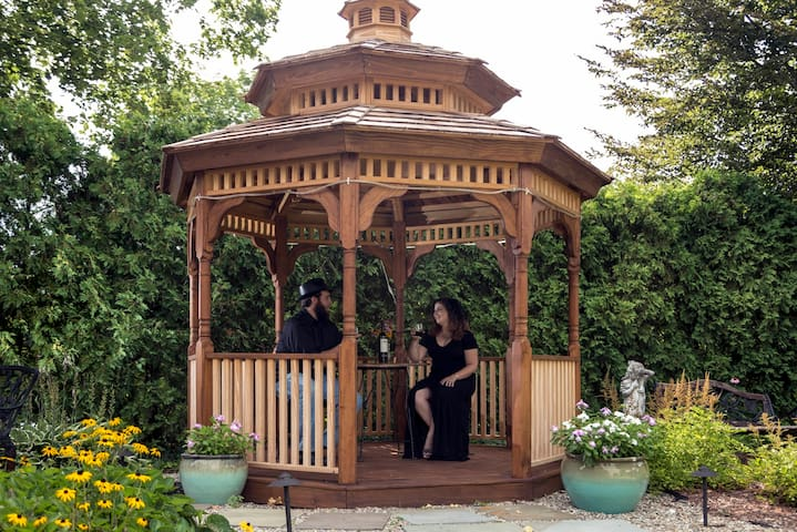Enjoy morning coffee or a glass of wine in our garden gazebo