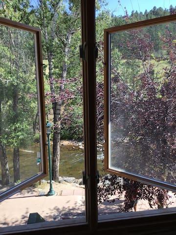 Bedroom window view to Big Thompson River below