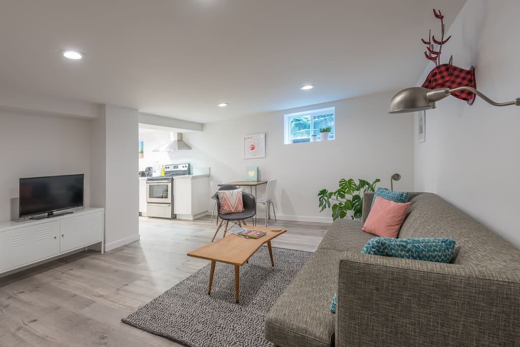 Make yourself at home in the bright daylight basement apartment with full kitchen