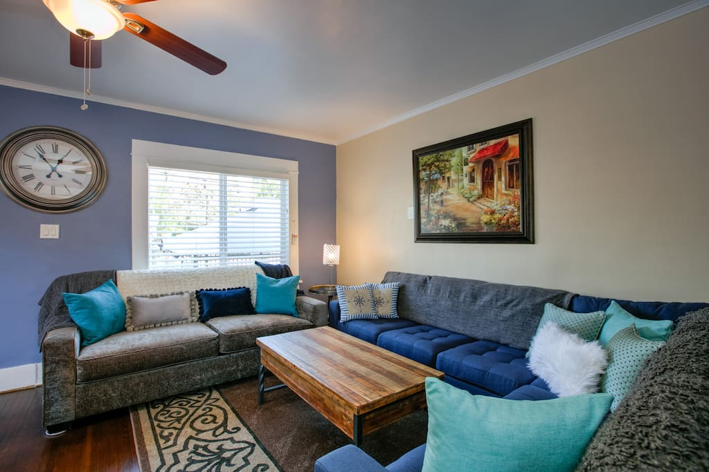 The living room with a queen-size sleeper sofa and sectional couch for 10 guests