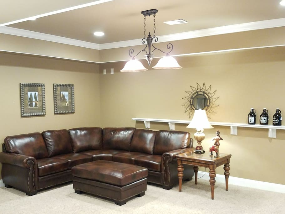 Sitting / Family area.  Two lamps above the ottoman can dim for setting a relaxing mood.