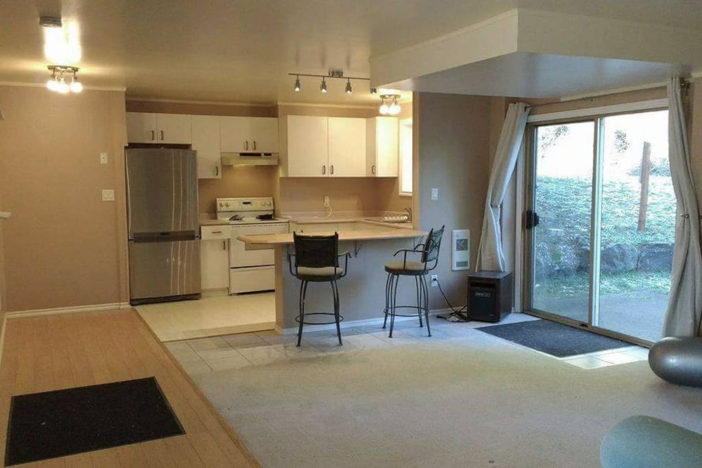 large open concept living space, patio door to fenced yard