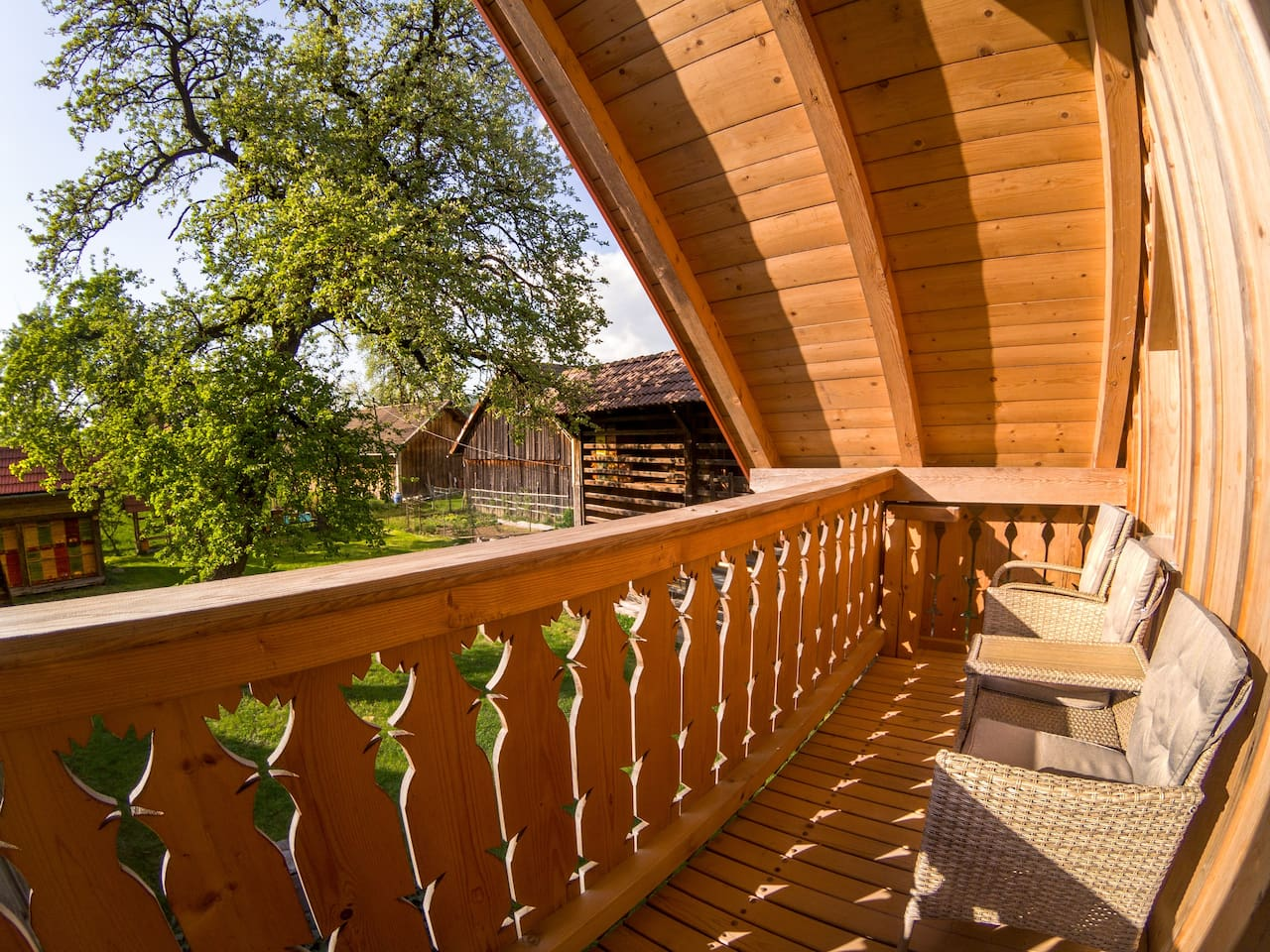 Enjoy morning coffee with views of the garden from the traditional Slovene balcony.