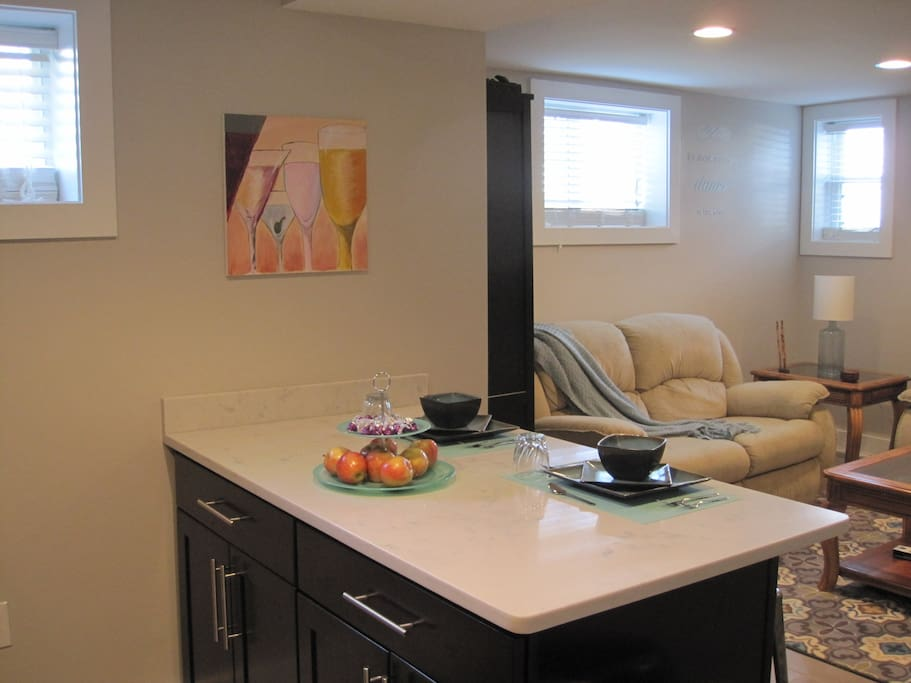 Kitchen opens to spacious, comfortable, well-lit living room