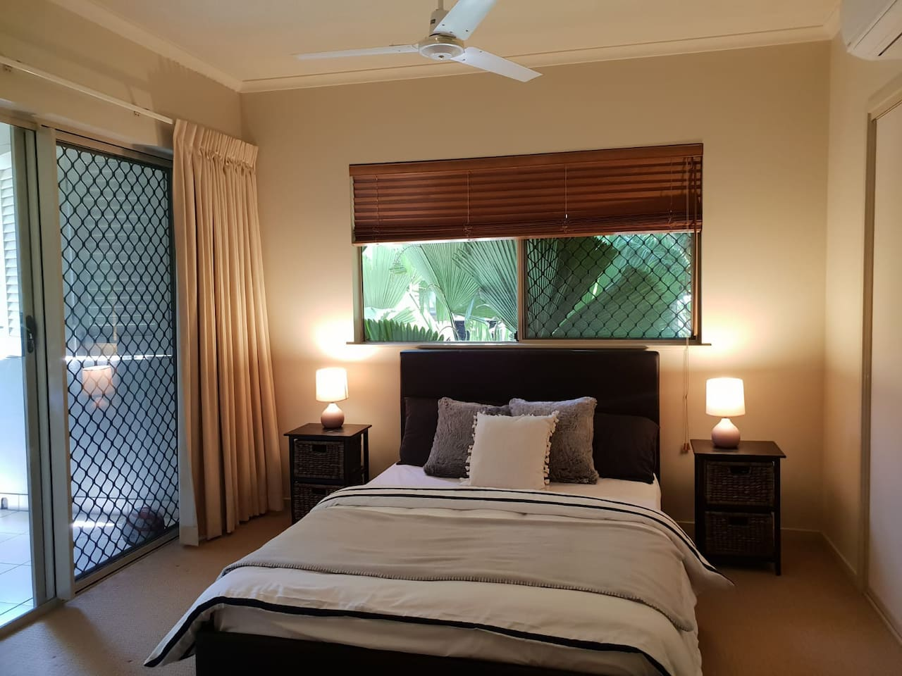 You room - The master bedroom with luxurious bed linen(Set1), two side tables for storage, 4 charging stations, aircon and carpeted flooring
