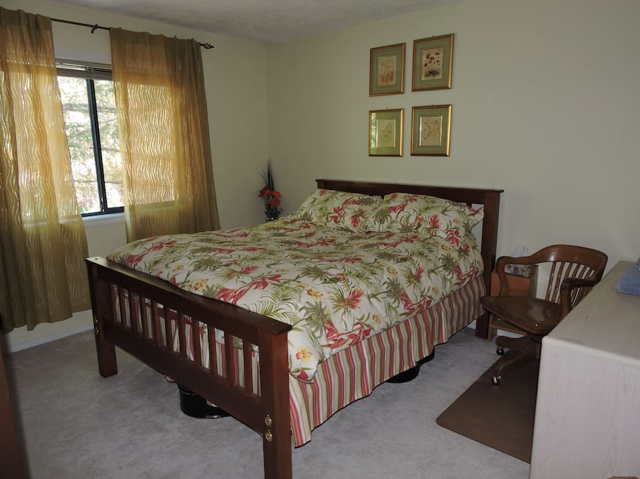 Main bedroom hand made shaker queen bed, desk, chair, forest views