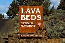 Lava Beds National Monument has numerous lava tube caves, with 25 having marked entrances and developed trails for public access and exploration. The monument also offers trails through the high Great Basin xeric shrubland desert landscape and the volcanic field.