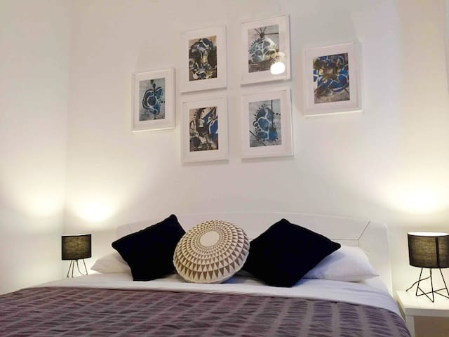 Modern bright room with large double bed