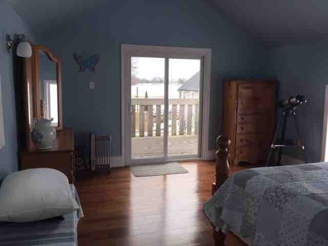 Master bedroom upstairs with private deck