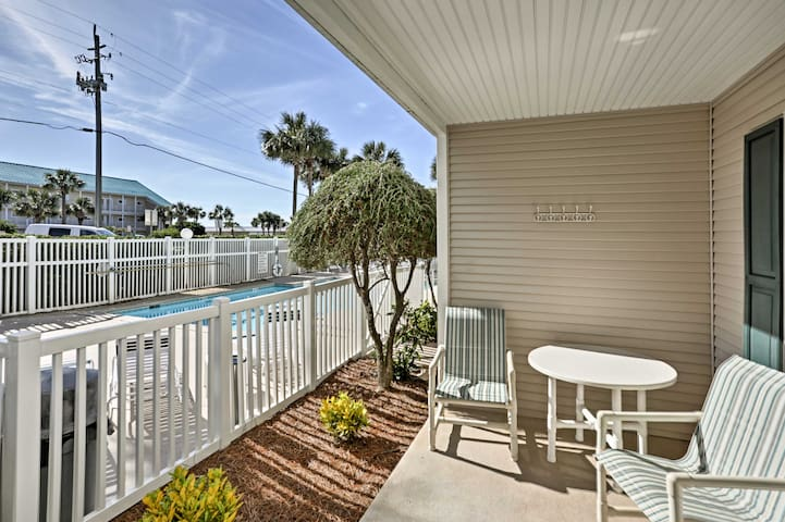 Your private porch overlooks the community pool.
