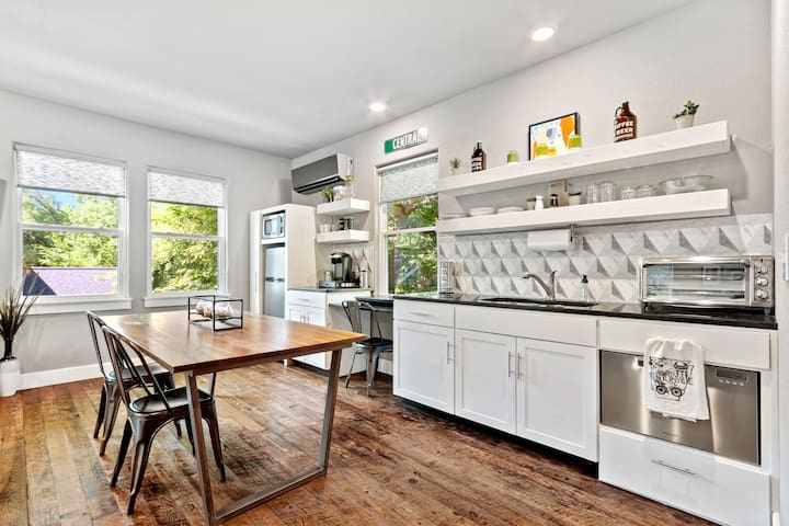 Fully stocked kitchen features convection toaster oven and a 2-burner cooktop, as well as microwave, refrigerator/freezer and dishwasher.
