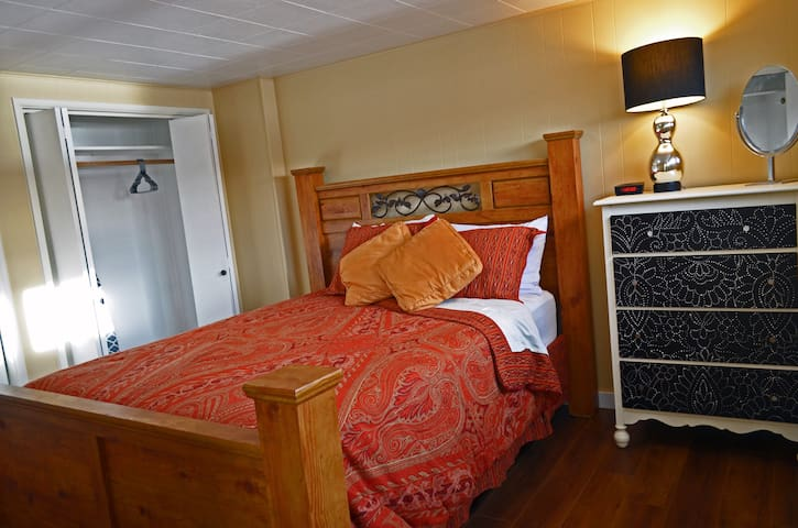 Queen size bed, dresser, luggage rack and space for you to relax