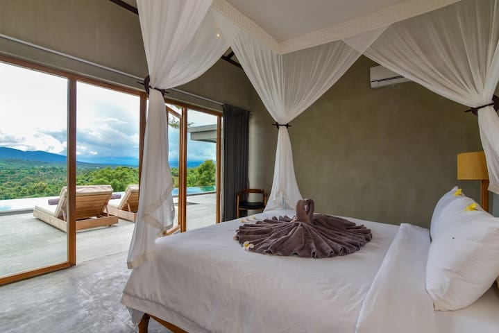 Bedroom with a double bed  with pool and mountain views