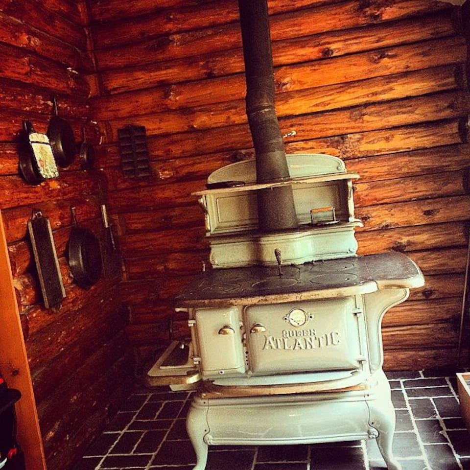Queen Atlantic Wood Stove - can use to cook or heat the house. We do have an electric stove as well.